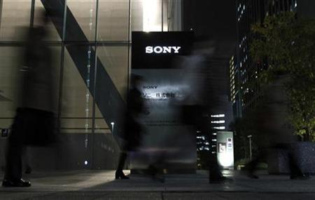 People walk in front of the Sony Corp's headquarters in Tokyo in this November 25, 2010 file photo. REUTERS/Toru Hanai