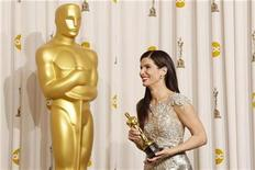 "<p>Sandra Bullock smiles with her best actress Oscar after winning for her role in ""The Blind Side"" backstage at the 82nd Academy Awards in Hollywood March 7, 2010. REUTERS/Lucy Nicholson</p>"