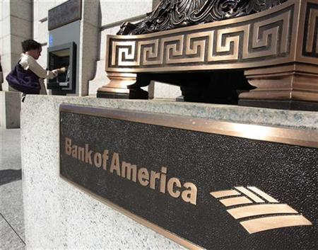A Bank of America customer uses an ATM machine outside a branch in Washington October 8, 2010. REUTERS/Richard Clement