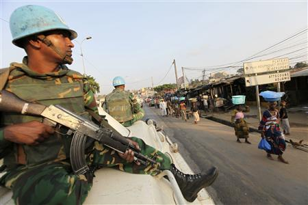 U.N. soldiers patrol along a street in the Attiecoube area of Abidjan December 27, 2010. REUTERS/Luc Gnago