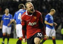 <p>Manchester United's Wayne Rooney celebrates scoring a penalty kick during their Champions League soccer match against Rangers in Glasgow, Scotland November 24, 2010. REUTERS/Russell Cheyne</p>