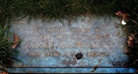 The plaque that marks the grave of James Hanratty, who was hanged in 1962 for the murder of Michael Gregsten, at the Carpenters Park Lawn Cemetery in Oxhey April 15, 2002. REUTERS/Russell Boyce