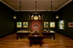 <p>Straight-on view of the living room gallery, as seen from the reception hall gallery, showing the Turtleback globes and hanging shades, Lunette window, and Four Seasons windows. Reuters/Raymond Martinot for The Charles Hosmer Morse Museum of American Art.</p>