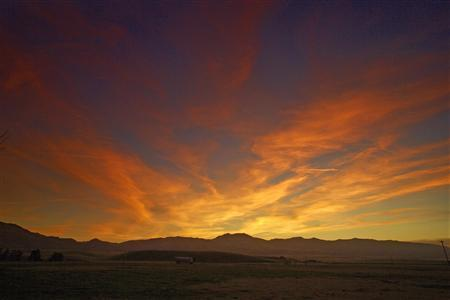 The sun sets over the Panoche Valley of California in this December 7, 2010 file photo. REUTERS/Phil Hawkins/Files