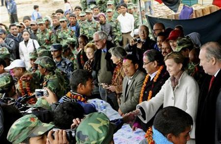 Representative of the United Nations Secretary-General to Nepal, and head of the U.N. Mission in Nepal (UNMIN) Karin Landgren (2nd R) shakes hands with discharged Maoist fighters during a ceremony in Dahaban, far west Nepal February 8, 2010. REUTERS/UNMIN/Handout