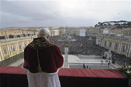Pope Benedict XVI delivers a Christmas Day message from the central balcony of Saint Peter's Square at the Vatican, December 25, 2010. REUTERS/Osservatore Romano