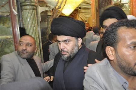 Anti-U.S. Shi'ite cleric Moqtada al-Sadr visits the Imam Ali shrine upon his return to Iraq, in Najaf, south of Baghdad, January 5, 2011. REUTERS/Handout by Sadr office