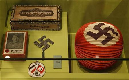 Exhibits with the Nazi swastika are displayed at the media preview of the exhibition ''Hilter und die Deutsche Volksgemeinschaft und Verbrechen'' (Hitler and the German Nation and Crime) at the Deutsche Historisches Museum (German Historical Museum) in Berlin October 13, 2010. REUTERS/Fabrizio Bensch (GERMANY - Tags: SOCIETY POLITICS)