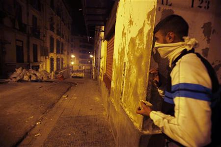An Algerian protester holds a stone during clashes with the police in Bab el-Oued district of Algiers January 6, 2011. Hundreds of youths clashed with police in several cities in Algeria, including the capital, over food price rises and chronic unemployment, residents said. REUTERS/Farouk Batiche
