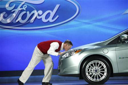 Ford CEO Alan Mulally kisses the hood of a just announced Ford Focus Electric as it arrived on stage for his keynote address at the Consumer Electronics Show (CES) in Las Vegas January 7, 2011. REUTERS/Rick Wilking
