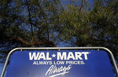 The Wal-Mart logo is seen on a sign in Phoenix, Arizona, February 18, 2010. Wal-Mart Stores Inc, the world's biggest retailer, releases its fourth quarter earnings report on on Thursday. REUTERS/Joshua Lott