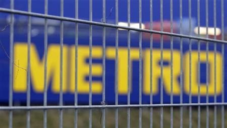 The company logo of German retail group Metro AG is pictured behind a fence in Berlin, January 20, 2009. REUTERS/Tobias Schwarz