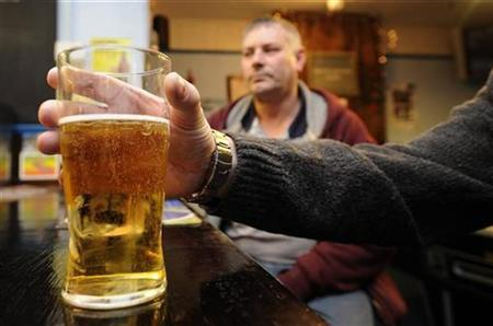 Leon Bannister poses with a pint of beer at the Bricklayers Arms, in Grays, Essex January 4, 2011. REUTERS/Paul Hackett