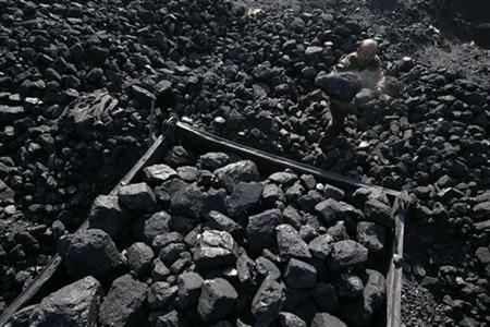 A worker loads coal onto a cart at a coal mine in Taiyuan, Shanxi province November 4, 2010. REUTERS/Stringer