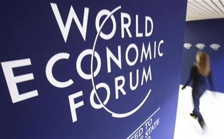 An attendee walks past logos of the World Economic Forum (WEF), at the congress centre of the Alpine resort of Davos, the venue of the Forum, January 31, 2010. REUTERS/Arnd Wiegmann