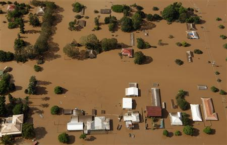 Residential areas west of Brisbane are inundated by flood waters January 13, 2011. REUTERS/Tim Wimborne