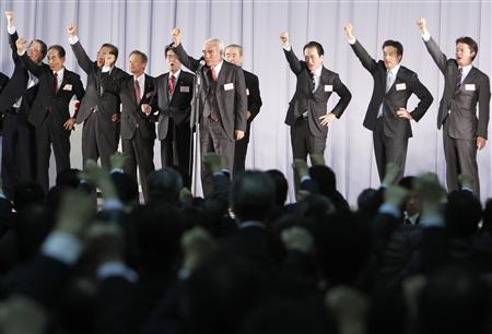 Japan's Prime Minister Naoto Kan (3rd R) raises his fists with party members during an annual party convention of the ruling Democratic Party of Japan in Chiba, east of Tokyo, January 13, 2011. Kan will appoint former administrative reform minister Yukio Edano as his de facto deputy and offer ex-finance minister Kaoru Yosano, a fiscal conservative, a government post, Japanese media said a day ahead of the changes. REUTERS/Kim Kyung-Hoon