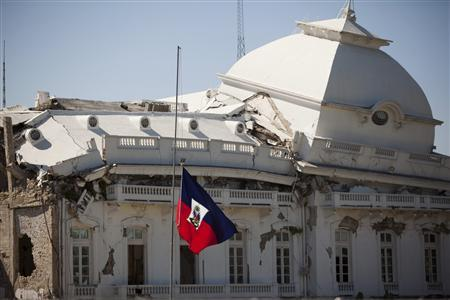 The Haitian national flag stands at half mast at the National Palace during the one-year anniversary of the 2010 quake in downtown Port-au-Prince, January 12, 2011. REUTERS/Allison Shelley