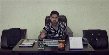 Dilpazeer Awan, a property adviser and the brother of Malik Mumtaz Hussain Qadri, the gunman detained for the killing of Punjab Governor Salman Taseer, sits in his office near his house in Rawalpindi January 15, 2011. REUTERS/Mian Khursheed