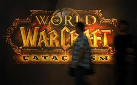 A visitor walks past a placard of 'World of Warcraft' at their exhibition stand at the Gamescom 2010 fair in Cologne in this August 18, 2010 file photo. REUTERS/Ina Fassbender