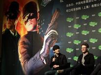 """<p>Актеры """"Зеленого шершня"""" Сет Роген (справа) и Джей Чоу (слева) на пресс-конференции в Пекине 17 января 2011 года. В прошедшие выходные боевик """"Зеленый шершень"""" стал лидером североамериканского проката, несмотря на негативные отзывы о киноадаптации комикса про супергероя. REUTERS/Jason Lee</p>"""