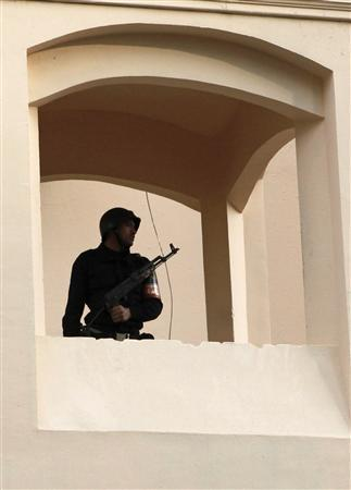 An armed police officer stands guard in the Ministry of Interior near the Parliament building in Cairo, January 17, 2011. REUTERS/Asmaa Waguih
