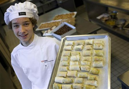 Max Kipp, a student at the Rijn IJssel school for chefs, displays a tray of springrolls filled with grasshoppers in Wageningen January 12, 2011. REUTERS/Jerry Lampen (NETHERLANDS - Tags: ANIMALS FOOD SOCIETY ODDLY)