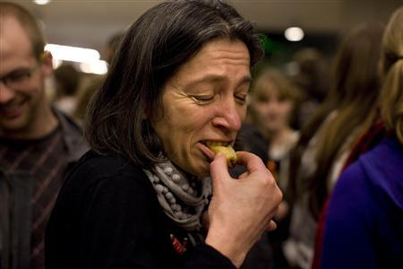 People try an insect snack during a break in the lecture given by Professor Arnold van Huis at the University of Wageningen January 12, 2011. REUTERS/Jerry Lampen