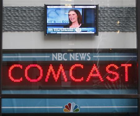 The news ticker outside the Today Show announces GE's sale of NBC to Comcast, in New York in this December 3, 2009 file photo. REUTERS/Chip East/Files