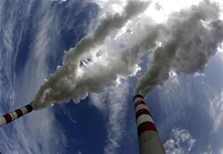 Smoke bellows from the chimneys of Belchatow Power Station, Europe's largest biggest coal-fired power plant, in this May 7, 2009 file photo. EUTERS/Peter Andrews/Files