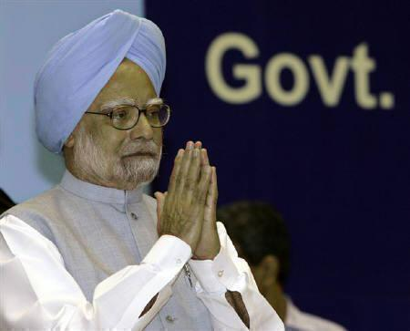 India's Prime Minister Manmohan Singh gestures during the national communal harmony awards ceremony in New Delhi August 12, 2009. REUTERS/B Mathur/Files