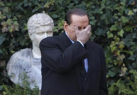 Italy's prime minister Silvio Berlusconi gestures as he attends a meeting with Slovenia's president Danilo Turk at the Villa Madama in Rome January 18, 2011. REUTERS/Alessandro Bianchi