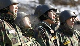<p>Students shout at a winter military boot camp during a media opportunity at a military unit in Bucheon, west of Seoul January 20, 2011. REUTERS/Lee Jae-Won</p>