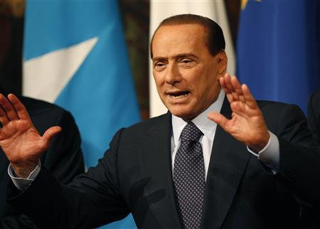 Italian Prime Minister Silvio Berlusconi reacts during a meeting with Somalia's Prime Minister Mohamed Abdullahi Mohamed at Chigi palace in Rome January 20, 2011. REUTERS/Tony Gentile