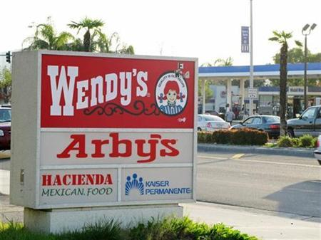 A combined Wendy's/Arby's sign is shown near a restaurant in Fontana, California January 6, 2009. REUTERS/Lisa Baertlein
