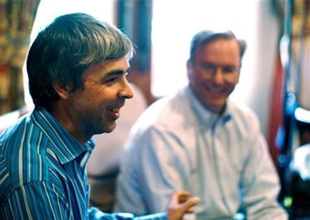 Google co-founder Larry Page talks to reporters as CEO Eric Schmidt looks on, in Sun Valley, July 9, 2009. REUTERS/Rick Wilking