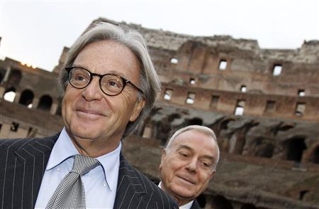 Tod's Group president Diego Dalla Valle (L) poses with Italian Cabinet Undersecretary Gianni Letta at the ancient Colosseum in Rome January 21, 2011. REUTERS/Tony Gentile