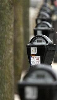 Parking meters run by LAZ Parking for Morgan Stanley are pictured in Chicago March 18, 2009. REUTERS/John Gress