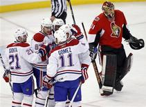 <p>Montreal Canadiens' (L-R) Brian Gionta, Max Pacioretty, P.K. Subban, James Wisniewski and Scott Gomez celebrate their fourth goal of the night as Ottawa Senators' goaltender Mike Brodeur skates to the bench after being pulled from the game during the second period of their NHL hockey game in Ottawa January 21, 2011. REUTERS/Blair Gable</p>