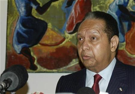Former Haitian dictator Jean-Claude ''Baby Doc'' Duvalier attends a news conference in Port-au-Prince January 21, 2011. REUTERS/St-Felix Evens