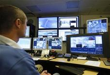 <p>Aviram Yaacov, computer systems coordinator at Ben Gurion University's security department, uses BriefCam's video synopsis programme at the university in the southern city of Beersheba January 16, 2011. REUTERS/Amir Cohen</p>