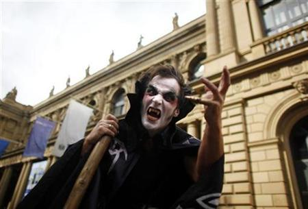 A demonstrator dressed as a vampire gestures in front of Frankfurt's stock exchange, September 15, 2010. REUTERS/Kai Pfaffenbach
