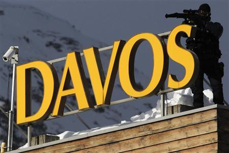 A member of Swiss special police forces stands on the roof of a hotel in Davos January 25, 2011. REUTERS/Christian Hartmann