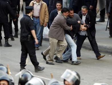 Plainclothes police arrest a protester during clashes in Cairo January 26, 2011. REUTERS/Asmaa Waguih