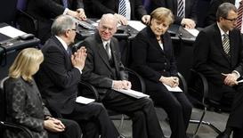 <p>President of the German Constitutional Court Andreas Vosskuhle (R-L) German Chancellor Angela Merkel, President of the Bundesstag Norbert Lammert, Zoni Weisz representative of German head of the central council of the Sinti and Roma and President of the Upper House of Parliament Bundesrat Hannelore Kraft attend a commemoration service for the victims of national socialism, on International Holocaust Memorial Day, at the Reichstag building, seat of the German lower house of Parliament Bundestag, in Berlin, January 27, 2011. REUTERS/Tobias Schwarz</p>