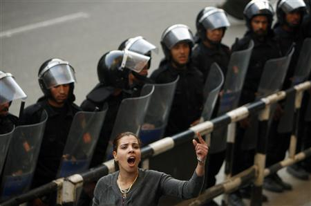 Mariam Solayman, a member of an Egyptian activist group, shouts anti-government slogans in front of a police cordon during a demonstration outside the press syndicate in central Cairo January 27, 2011. REUTERS/Yannis Behrakis