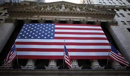 U.S. flags hang on the facade of the New York Stock Exchange October 8, 2009. REUTERS/Chip East