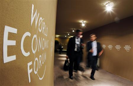 Participants pass a World Economic Forum (WEF) logo in Davos January 27, 2011. REUTERS/Christian Hartmann