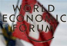 <p>Switzerland's national flag is reflected in a sign for the World Economic Forum (WEF) in Davos January 27, 2011. Organisers and CEOs at the annual Davos meeting projected cautious confidence in the global economy as the event opened on Wednesday, pointing to numerous risks which could yet derail a still-fragile recovery. REUTERS/Christian Hartmann</p>