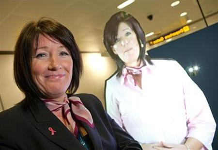 Julie Capper poses next to her hologram in a photo courtesy of Manchester Airport. REUTERS/Manchester Airport